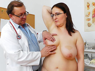 Doctor checks chubby brunette's big tits and trimmed pussy
