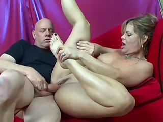 Kelly Leigh and Rod Fontana are fucking on the red sofa