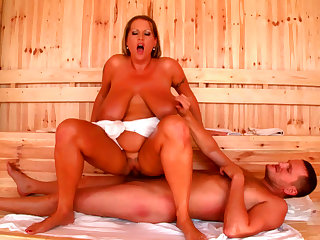 Big booty babe Laura M is sucking cock in the sauna