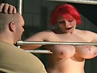 Fat girl tits are hit by hot wax
