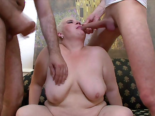 Blonde BBW enjoys two cocks