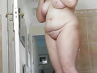 Boobs and belly of mature Brit wife